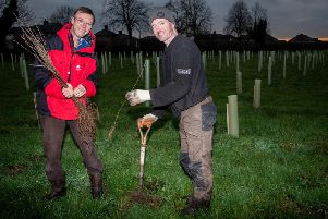 Phil Dykes from Woodland Trust with Richard Atton from Bowland Treecraft Ltd as they plant the new trees