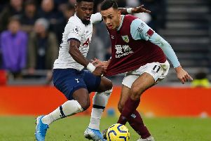 Burnley's Dwight McNeil takes on Serge Aurier at the Tottenham Hotspur Stadium