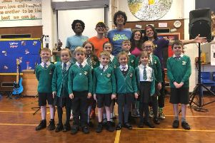 Presenter Andy Day, the Odd Socks band and pupils from the school