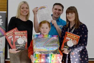 Poppy Booth with Neil Floyd, mum Jacqueline Booth and headteacher Christine Smith (left)