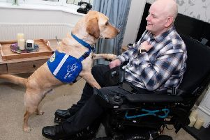John Newcombe with Casper, his award winning support dog