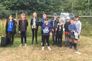 Yarnbury AC winners show off the Old Ball Cup and prizes donated by local businesses, proof that their future is in good hands.
