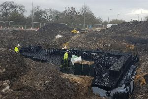 Picture shows a drainage attenuation tank being installed during construction last week.