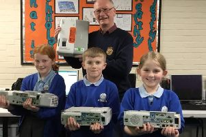 Rotarian David Bleazard with children from Barnacre Road Primary School, Longridge. donating projectors.