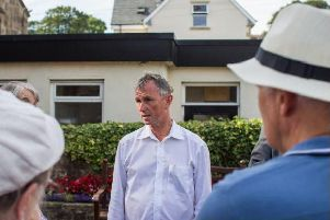MP Nigel Evans at a previous meeting about speeding with residents at the war memorial in Sabden.