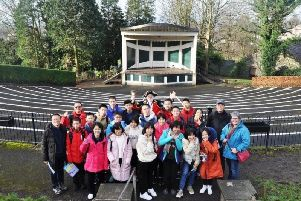 The exchange students at Clitheroe Castle bandstand with Clitheroe Town Crier Roland Hailwood.