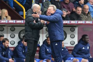 Cardiff City manager Neil Warnock remonstrates angrily with fourth official Anthony Taylor after referee Michael Dean reversed his second half penalty decision