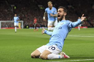 Manchester City's Bernardo Silva celebrates after scoring the opening goal.