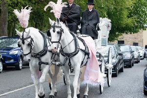 A white horse drawn carriage carried the coffin of Tia Taggart to her funeral in Padiham today.