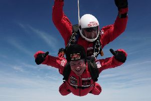 Chief constable Mike Barton during his charity skydive.