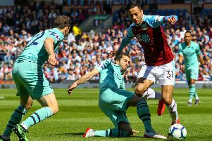 Burnley's Dwight McNeil battles with Arsenal's Henrikh Mkhitaryan and Stephan Lichtsteiner