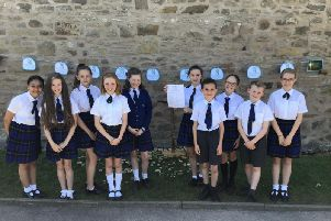 The school chaplains proudly displaying the results of their hard work.