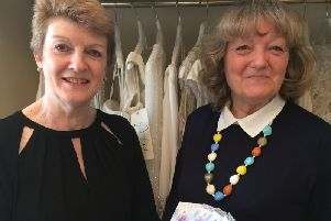 Marie, is pictured on the right, collecting her vouchers from Liz Metcalfe.