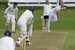 New South African signing Justin Dill in bowling action on his debut for Chesterfield.