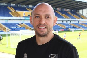 Richard Cooper says he is honoured to be named as Masnfield's new academy boss.
