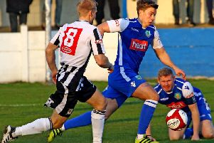 Clitheroe midfielder Charlie Russell in possession