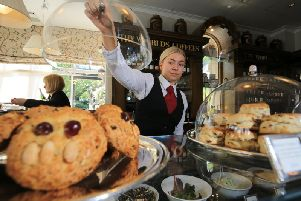 Following the life of a Fat Rascal from the bakery to Bettys Cafe Tea Rooms in Harrogate. Pictured is staff member Chrisie Deprez with a tray of Fat Rascal at the Cafe Tea Rooms. Picture: Chris Etchells