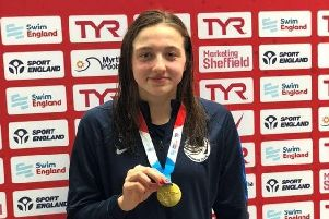 Proud Sophie Baker, of Chesterfield Swimming Club, clutching her gold medal.