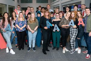 Burnley College students celebrate their A level success today.