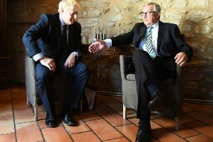 Prime Minister Boris Johnson with European Commission President Jean-Claude Juncker, inside Le Bouquet Garni restaurant in Luxembourg, prior to a working lunch on Brexit.