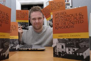 Mikey Swann at his home in Filey with copies of his new book. Picture by Richard Ponter