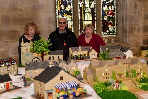 From left, Bakewell and Eyam Community Transport fundraiser Sandra Naylor, volunteer driver John Plant, and cake decorator extraordinaire Lynn Nolan.
