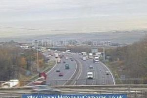 A broken down vehicle has led to delays on the M1.