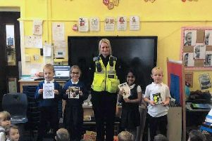 PCSO Janis Naylor with youngsters at Brimington Manor Infant and Nursery School
