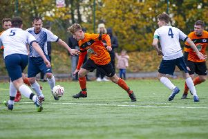 Howden Clough's Samuel Richards looks to take on the Morley Town defence during last Saturday's West Riding County Trophy tie. Picture: ScottMerrylees.