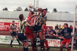 Preston striker Mike Conroy and defender David Moyes challenge in the Kidderminster box in the FA Cup in January 1994