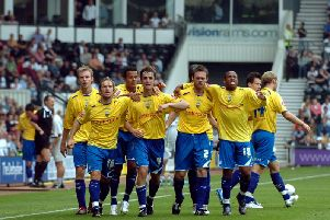 Preston's players celebrate Danny Pugh's equaliser against Derby at Pride Park in September 2006