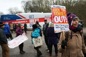 MATLOCK, ENGLAND - DECEMBER 05: Protesters demonstrate outside John Smedley Mill ahead of UK Prime Minister Boris Johnson's arrival on December 05, 2019 in Matlock, England. The UK will go to the polls on December 12, the third General Election in less than five years. (Photo by Hannah McKay - WPA Pool/Getty Images)