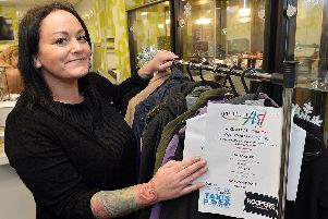 Suzanne Parsons, Piece of Art manager, with the rack of coats.