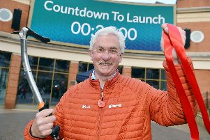 Derbyshire explorer Nigel Vardy cuts the ribbon to launch Vicar Lane shopping centre's new big screen in Chesterfield.