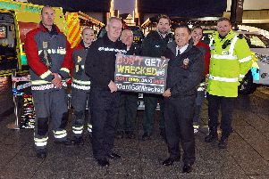 Chief constable Peter Goodman, of Derbyshire Police, front left, and deputy chief fire officer Rick Roberts, of Derbyshire Fire and Rescue Service, front right, with members of Police, fire and ambulance service at the launch of the Don't Get Wrecked campaign.