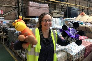 Julie Rowlandson, community ambassador for International Aid Trust, with some of the toys that have been donated to the organisation's Christmas gift appeal.
