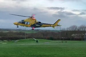 An Air Ambulance lands in Bainbridge Park after a crash in Carr Vale, Bolsover, involving a car and a motorbike