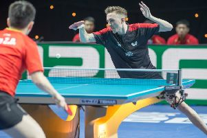 Liam Pitchford in action against world number two Fan Zhendong, of China. (PHOTO BY: Alan Man)