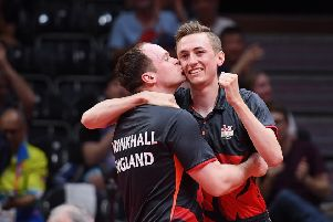 GOLD COAST, AUSTRALIA - APRIL 14:  (L-R) Paul Drinkhall and Liam Pitchford of England celebrate after defeating Sharath Achanta and Sathiyan Gnanasekaran of India during the Men's Doubles Gold Medal Table Tennis match on day 10 of the Gold Coast 2018 Commonwealth Games at Oxenford Studios on April 14, 2018 in Gold Coast, Australia.  (Photo by Matt Roberts/Getty Images)
