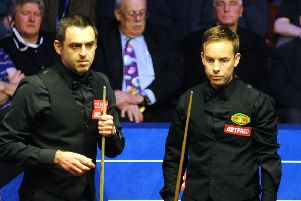 Ronnie O'Sullivan and Ali Carter during their second-round clash at the World Snooker Championships in Sheffield