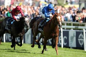 Masar, ridden by Willam Buick, storms home from Dee Ex Bee (far side) and Roaring Lion to spring an upset in the Investec Derby at Epsom.
