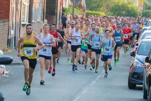 The runners are on their way in the historical Hardwick 10K race.
