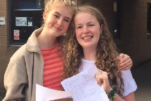 Highfields School students Laura and Jess collect their results.