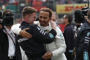 Mercedes driver Lewis Hamilton is congratulated by a member of his crew after claiming his fifth Formula 1 title the Mexico Grand Prix (Picture: Moises Castillo/AP).