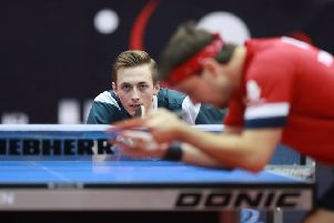 Liam Pitchford in action against Timo Boll. (PHOTO BY: Remy Gros/ International Table Tennis Federation).