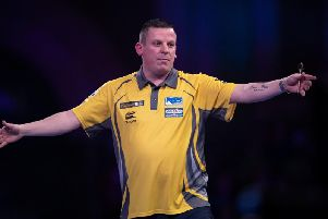 Dave Chisnall celebrates winning his match against Josh Payne during day four of the William Hill World Darts Championships at Alexandra Palace