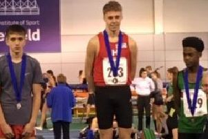 Gabriel Gisborne on the podium after winning his gold medal.