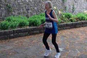 Sue Riley running at Clitheroe Castle.