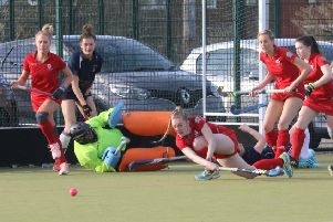 Jemma Hampson smashes the ball away to take pressure off Garstang