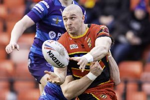 Adam Ryder offloads the ball to set up a Dewsbury Rams attack during last Sunday's 38-24 victory over Swinton Lions in the Betfred Championship.